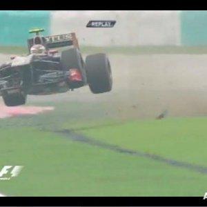 vitaly_petrov_malaysian_grand_prix_jump.jpg